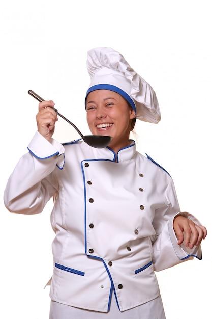 Mulher bonita em imagem de chef Foto gratuita