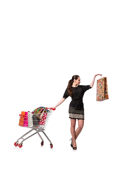 Mulher com carrinho de compras e sacos isolados no branco Foto Premium
