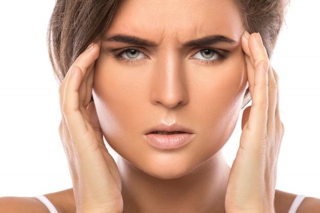 Mulher com dor de cabeça Foto Premium