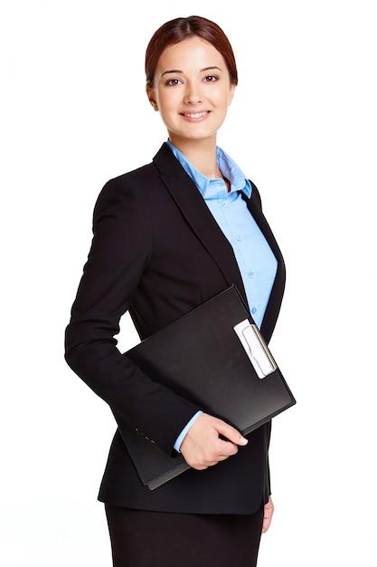 Mulher de negócios elegante que prende uma prancheta Foto gratuita