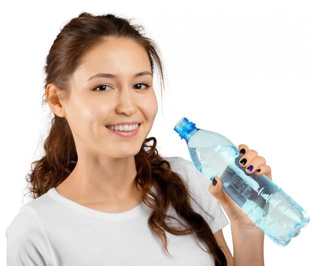 Mulher desportiva com água Foto Premium