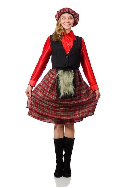 Mulher engraçada em roupas escocesas em branco Foto Premium