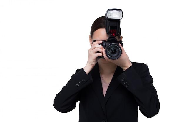 Mulher, fotógrafo, segure, câmera, com, externo, ponto flash, isolado, fundo branco Foto Premium