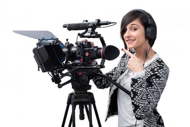 Mulher jovem, com, profissional, câmera video Foto Premium