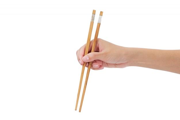 Mulher mão, segurando, chopsticks, isolado, branco Foto Premium