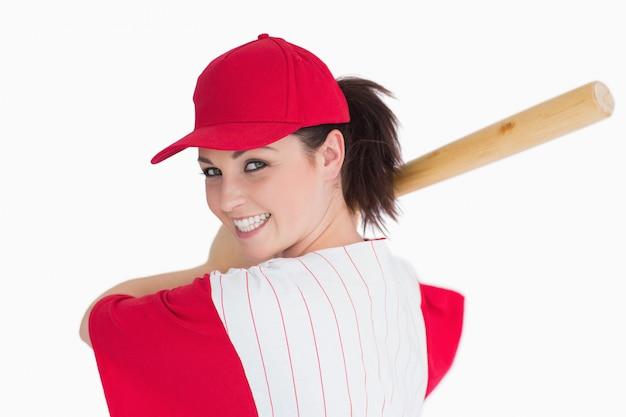 Mulher pronta para jogar com taco de beisebol Foto Premium