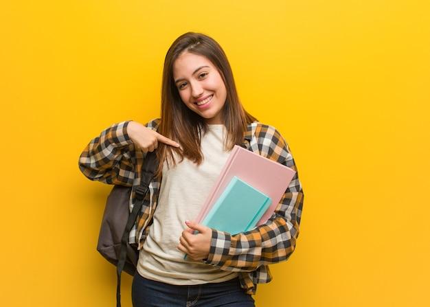 Mulher segurando cadernos Foto Premium
