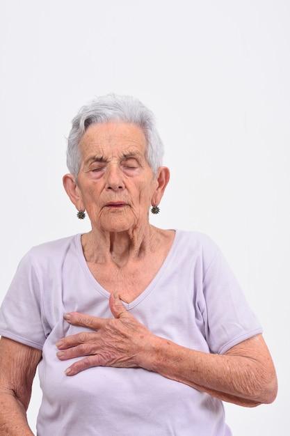 Mulher sênior, com, mão, para, a, coração, para, um, susto Foto Premium