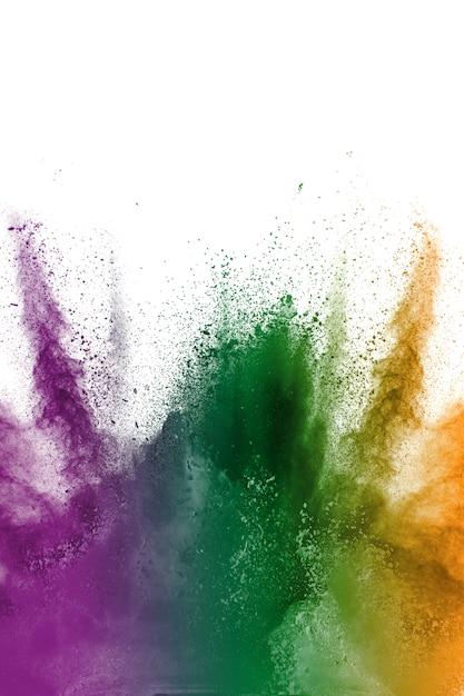 Multi explosão do pó da cor no fundo branco. Foto Premium