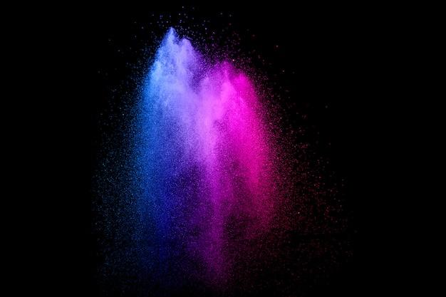 Multi explosão do pó da cor no fundo preto. Foto Premium