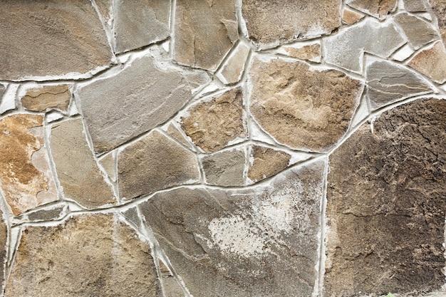 Muro de pedra estruturada em bruto Foto gratuita