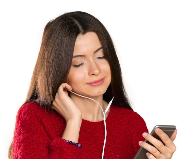 Música jovem feliz com fones de ouvido Foto Premium
