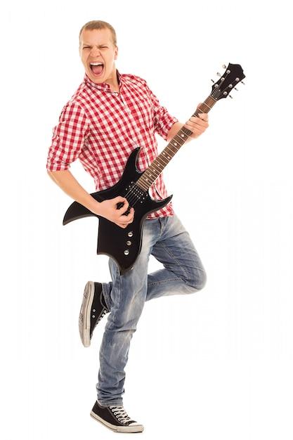 Música. jovem músico com uma guitarra Foto gratuita