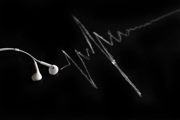 Música, pulso, coração. fundo preto, minimalismo. Foto Premium