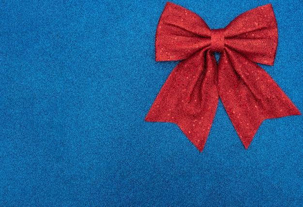 Natal ou feriado com laço vermelho Foto Premium