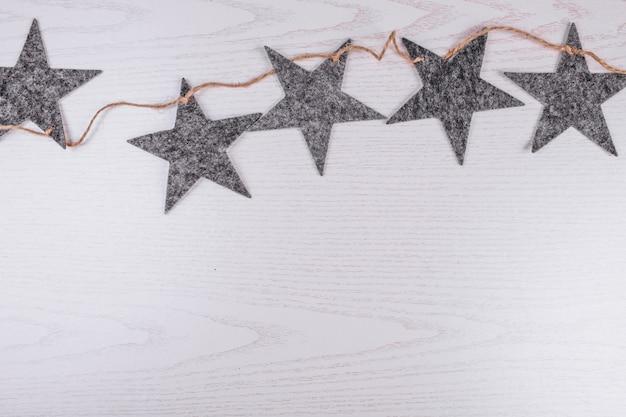 Natal plana leigos em fundo de madeira Foto gratuita