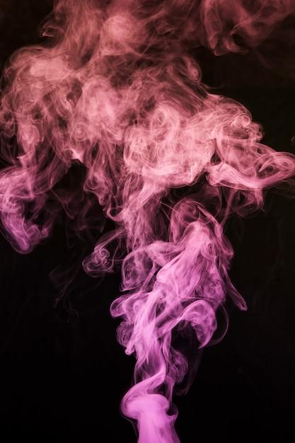 Neblina ou fumaça abstrata mover-se em fundo preto Foto gratuita