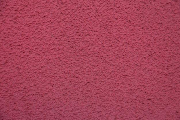 Nova parede de cimento rosa. estuque de concreto bonito. cimento pintado. parede de textura de fundo Foto Premium