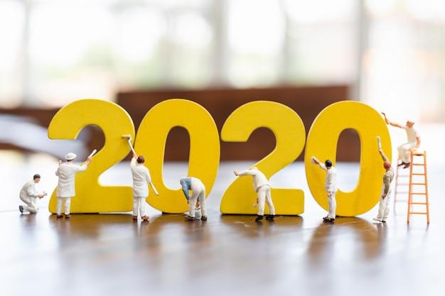 Número de pintura da equipe de trabalhadores em miniatura 2020 Foto Premium
