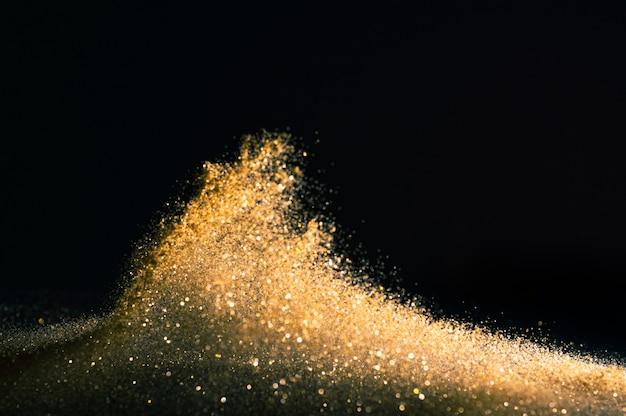 O brilho ilumina o fundo do grunge, brilho defocused ouro abstrato twinkly ilumina o fundo. Foto Premium