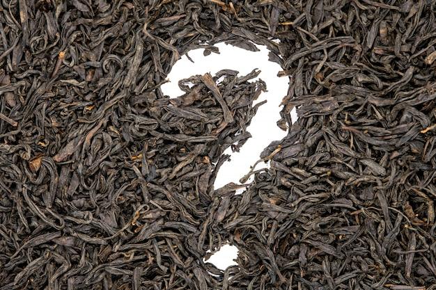O chá do souchong de lapsang, ponto de interrogação deu forma, ascendente próximo. Foto Premium