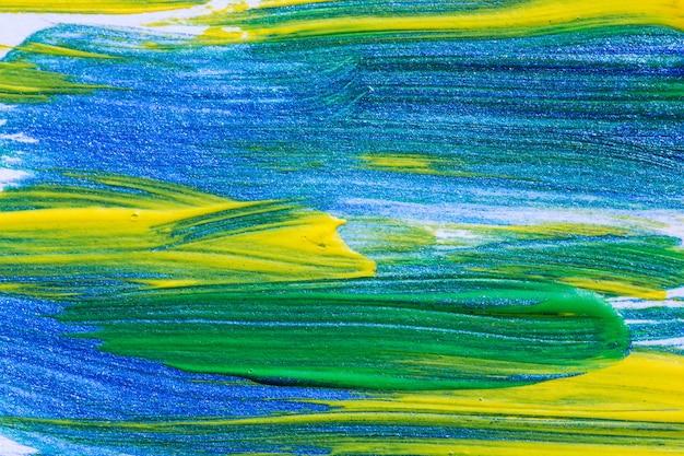 O close up disparou da pintura acrílica da textura colorida das pinceladas na lona Foto Premium