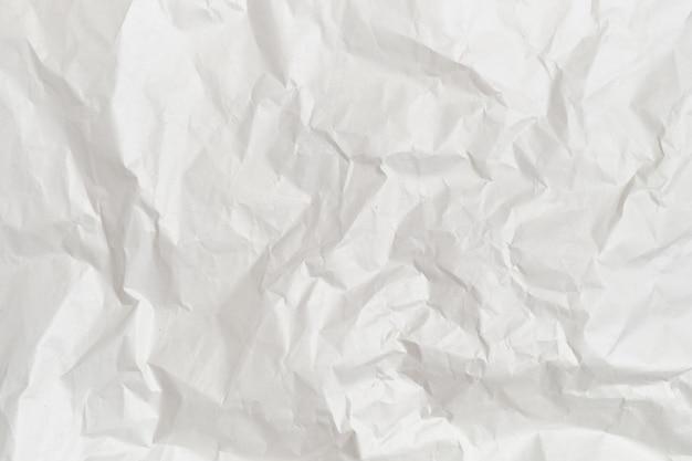 O fundo e a textura do papel amassado branco. Foto Premium