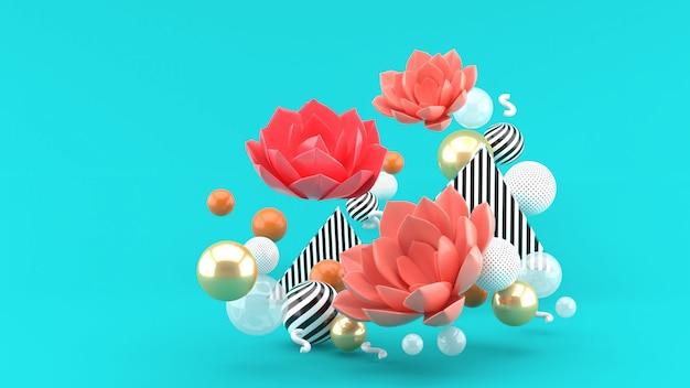O lótus rosa entre as bolas coloridas no espaço azul Foto Premium