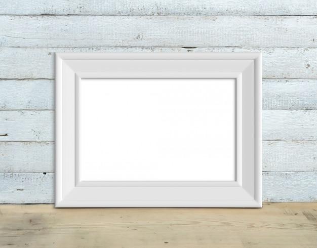 O modelo horizontal branco velho do quadro de madeira a4 horizontal está em uma tabela de madeira em um fundo de madeira branco pintado. estilo rústico, beleza simples. 3d rendem. Foto Premium