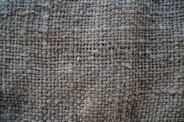 O pano de saco de hesse tecido textura de fundo na cor bege creme amarelo claro Foto Premium