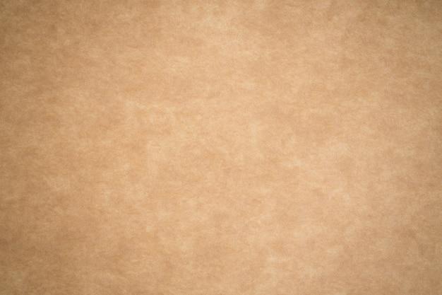 O papel marrom está vazio, fundo de papelão abstrato