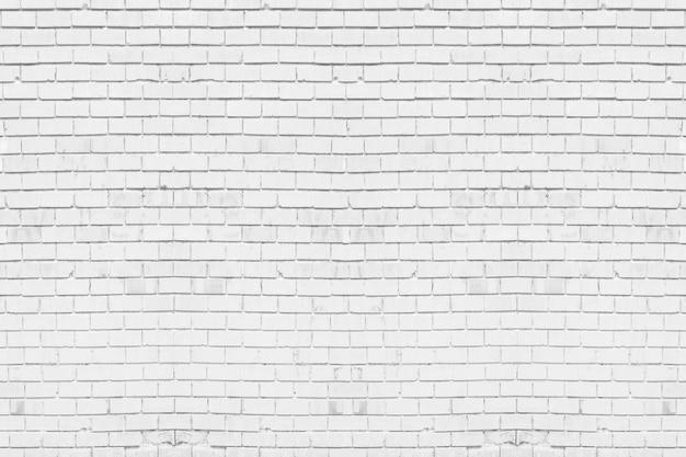 O sumário resistiu à textura manchada luz velha do estuque - cinza. fundo branco da parede de tijolo na sala rural. Foto Premium