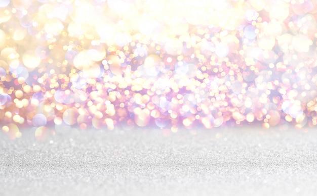 O vintage de prata e branco do brilho ilumina o fundo. desfocado Foto Premium