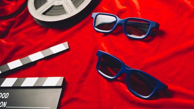 Óculos 3D e claquete perto da bobina de filme   Baixar fotos gratuitas ae5ba4a6a8
