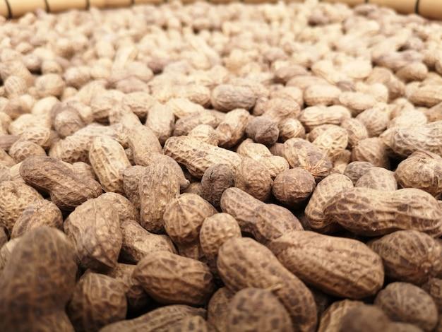 Os amendoins são ricos em proteínas. os nutrientes essenciais para o corpo. Foto Premium