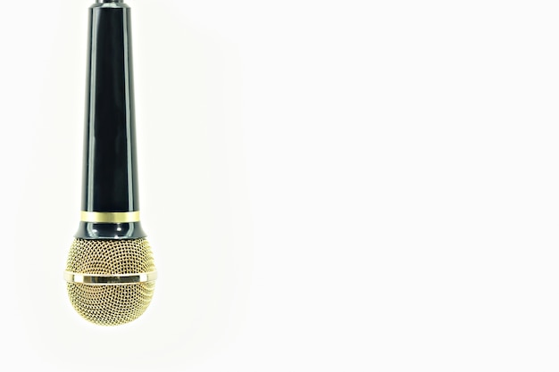 Ouro e preto do microfone no branco isolado. Foto Premium