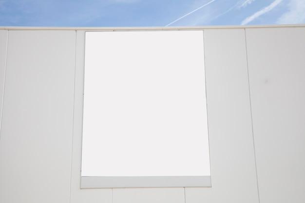 Outdoor de publicidade branco em branco na parede Foto gratuita