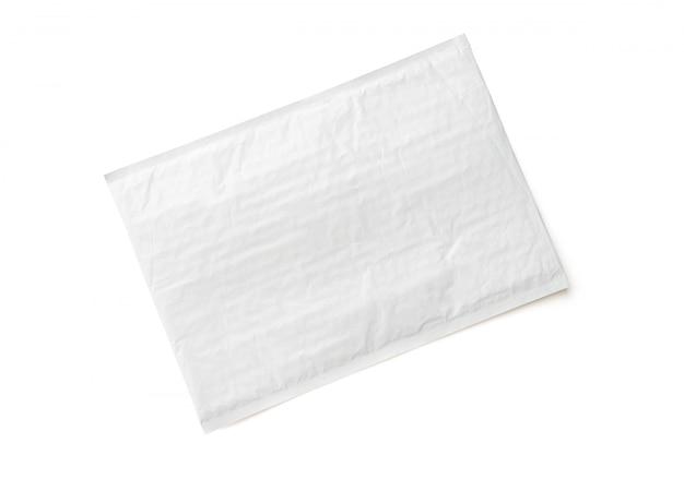 Pacote postal branco. fundo de objeto de parcela de plástico. Foto Premium