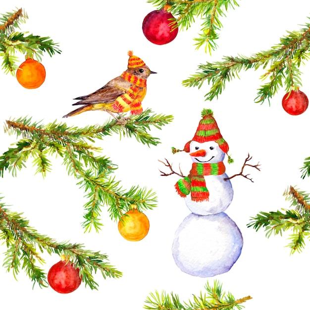 Padrão de galho de árvore de natal, boneco de neve e pássaro Foto Premium