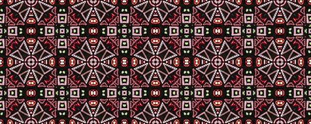 Padrão étnico brilhante. arte decorativa. padrão sem emenda em ziguezague vermelho verde marrom Foto Premium
