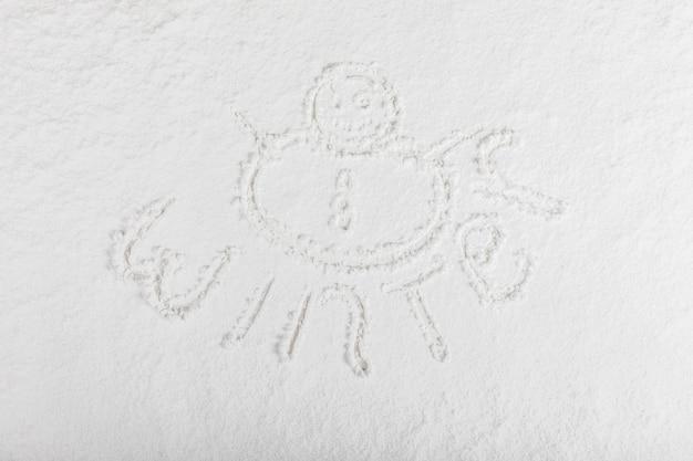 Palavra de inverno na superfície da neve Foto gratuita