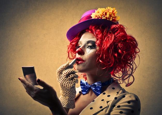 Palhaço, aplicando, maquiagem Foto Premium