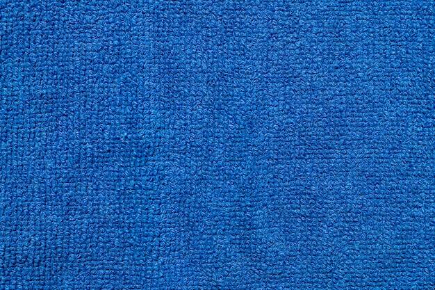 Pano de fundo de textura de tecido têxtil azul macio. Foto gratuita