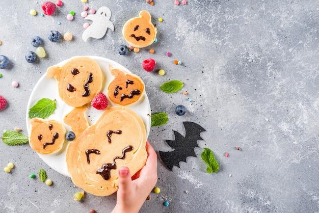 Panquecas engraçadas de crianças de halloween Foto Premium