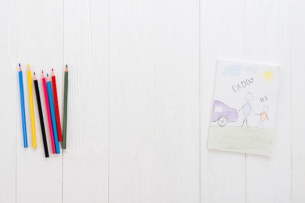 Papai e eu inscrição com lápis brilhantes Foto gratuita