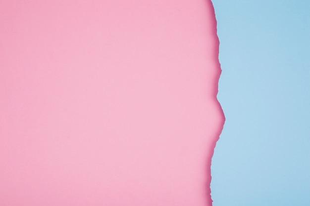 Papéis rasgados de cores pastel Foto gratuita