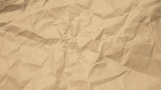 Papel amassado marrom close-up fundo de textura Foto Premium