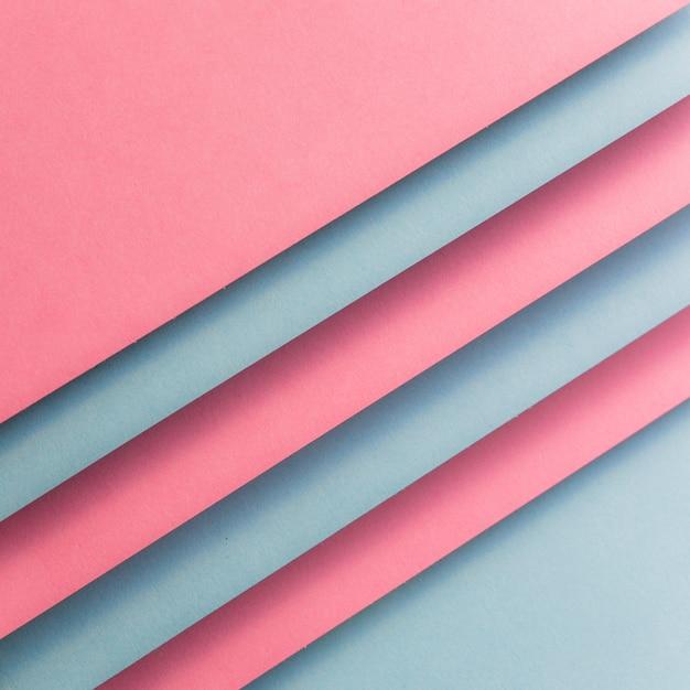Papel cartão rosa e cinza, formando linhas diagonais Foto gratuita