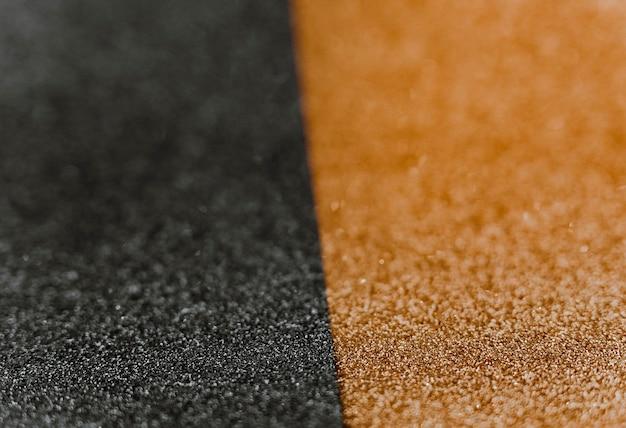 Papel de embrulho dourado e preto reluzente Foto gratuita