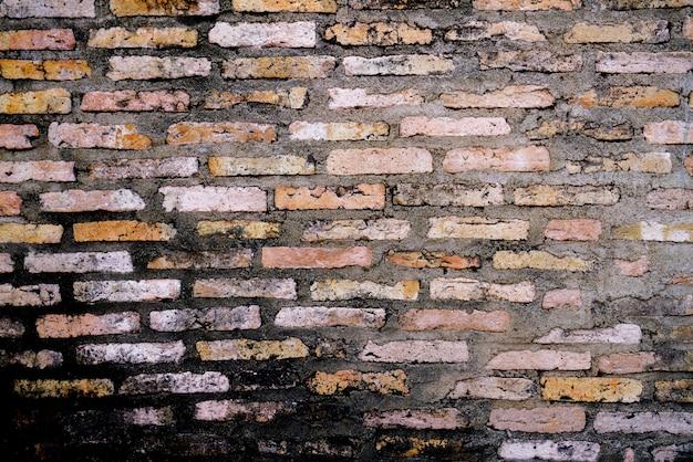 Papel de parede de fundo de tijolo velho & crack Foto Premium